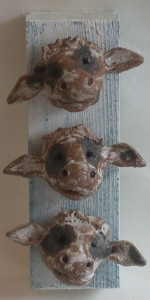 COWS HEADS on woodblock ,handmade, ceramic, studio pottery, cornwall, upcycled