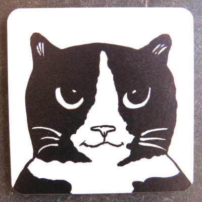 black and white cat head coaster