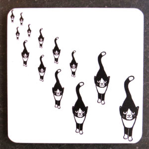 black and white stalking line of cats coaster
