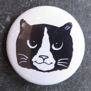 lapel pin badge - black and white cat