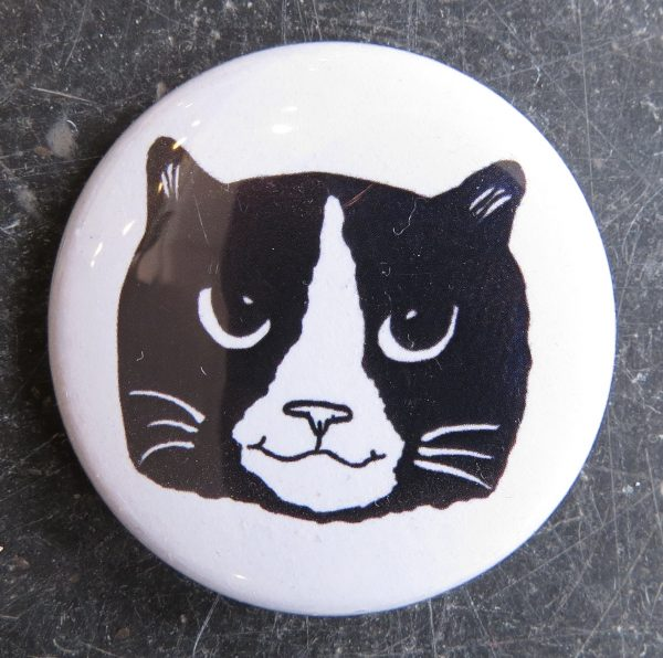 lapel pin, lapel badge, badges, black and white cat, artwork, cat illustration, jane adams, pawprint designs