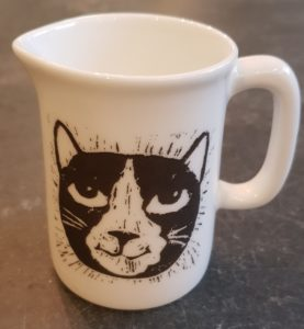 jug, china jug, cream jug, black and white cat, cat themed present, cat gifts, cat lovers, lino cut, pawprint designs, jane adams ceramics, st just, cornwall