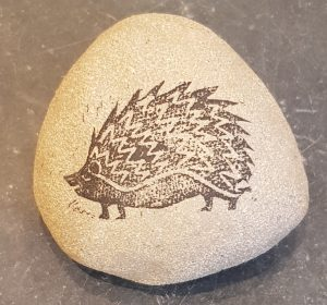 clay pebble, decorated pebble, linocut design, hedgehog, jane adams