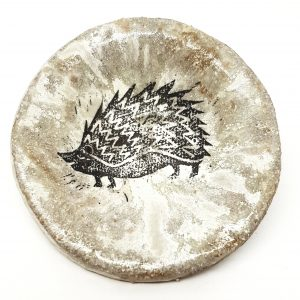 small trinket dish, round dish, round trinket dish, trinket bowl, hedgehog, linocut design, pawprint designs, jane adams ceramics, cornwall