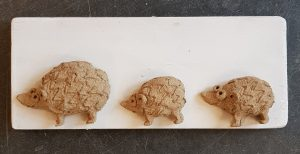 hedgehogs, hoglets, ceramic hedgehogs, hedgehog wall plaque, jane adams ceramics